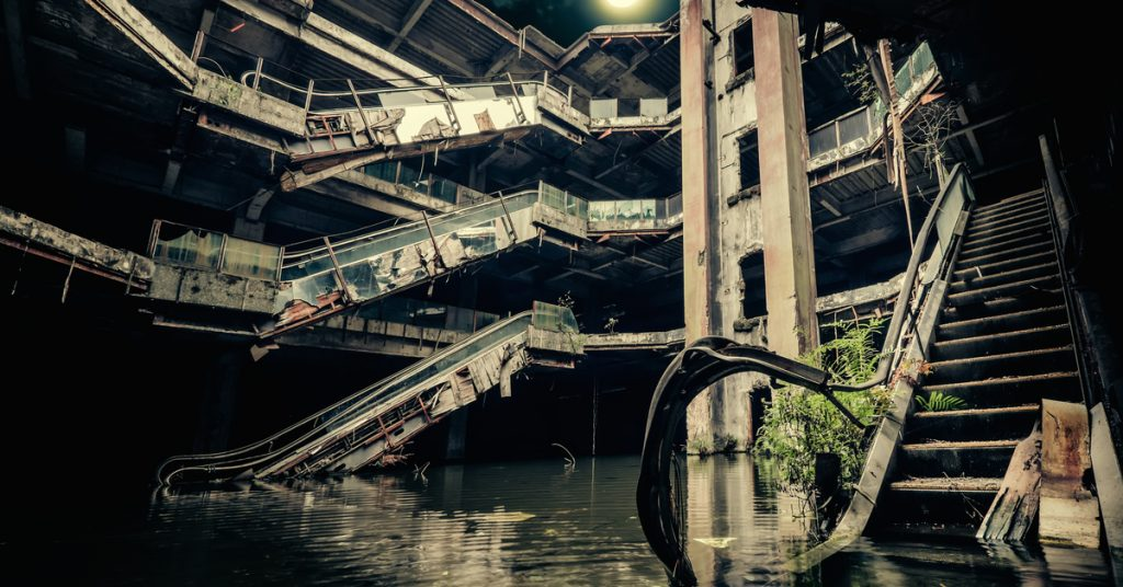 A photo of the inside of an abandoned and partially flooded shopping centre