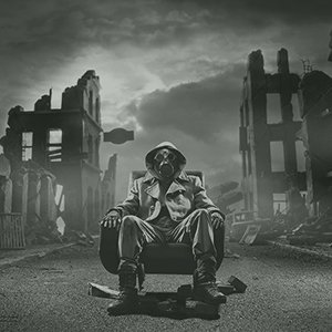 A picture of a person sitting on a chair wearing a gas mask with a post-apocalypse scene in the background including destroyed buildings.
