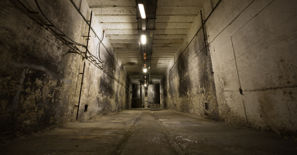 A photo of the basement of an abandoned commercial building.