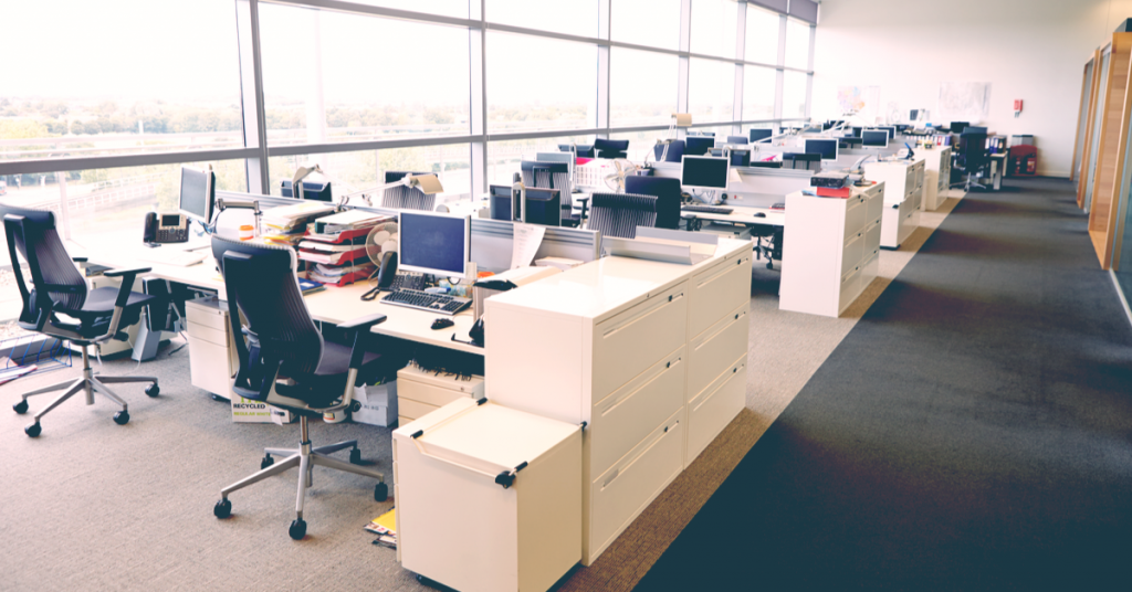 A photo of an open plan office with no people